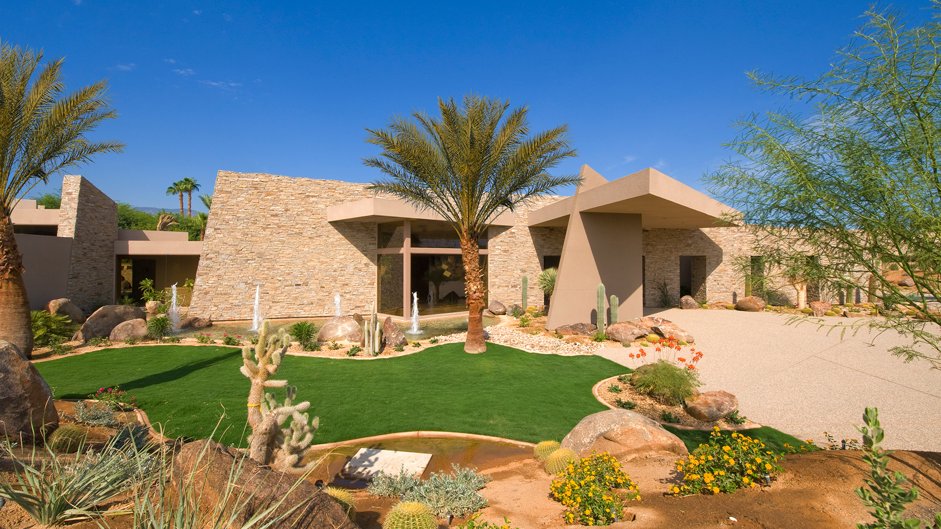 Home palm springs landscape design hardscaping and for Garden design with palms